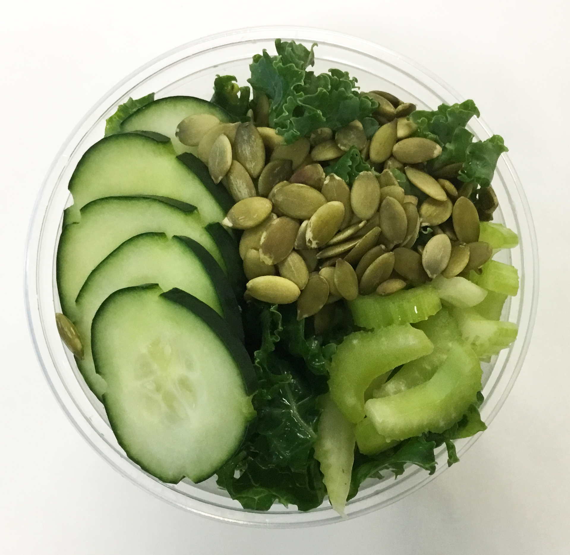 curly kale with cucumber, celery and roasted pumpkin seeds