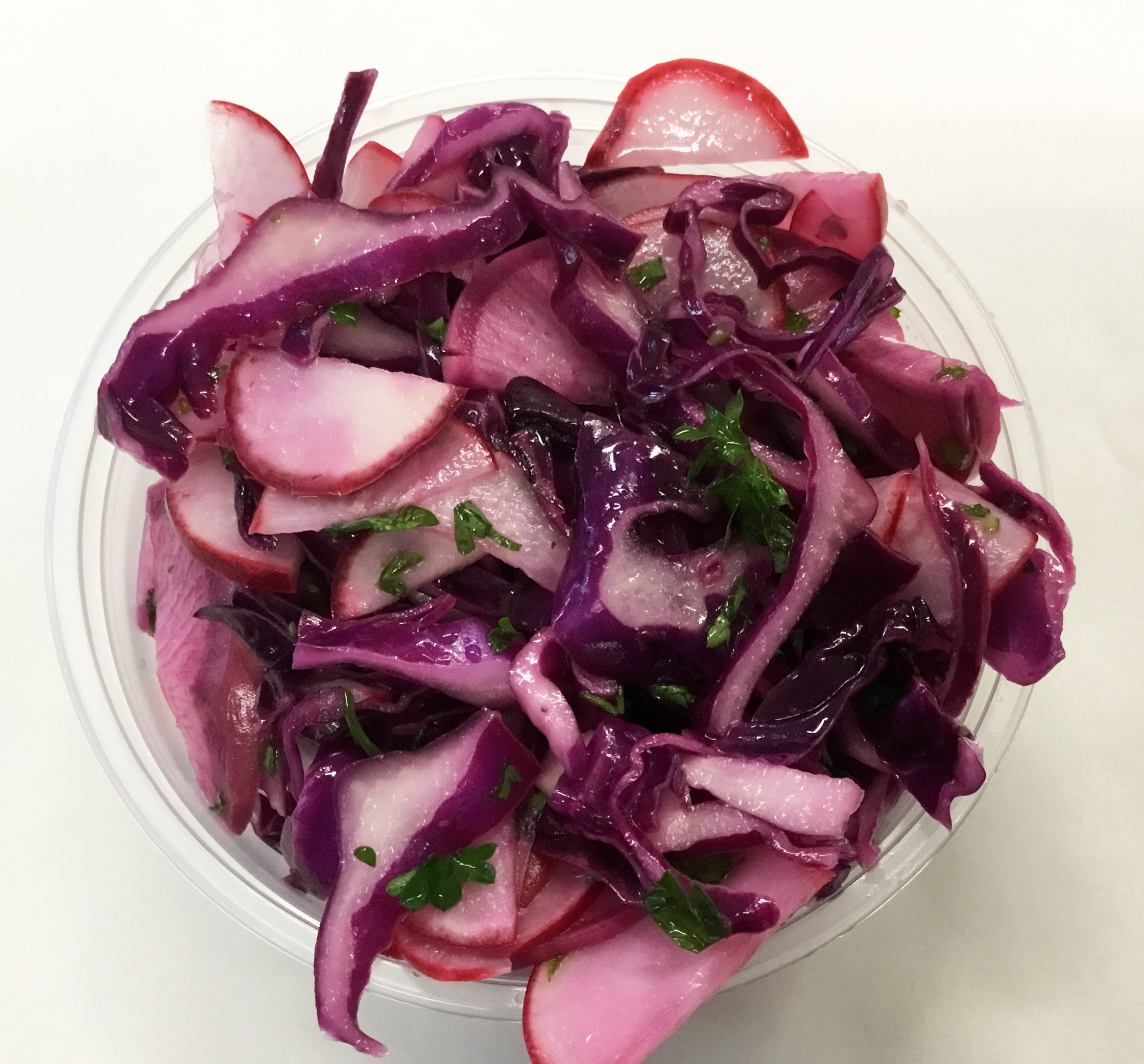 red slaw of cabbage, radishes, purple daikon and parsley, apple cider vinegar dressing