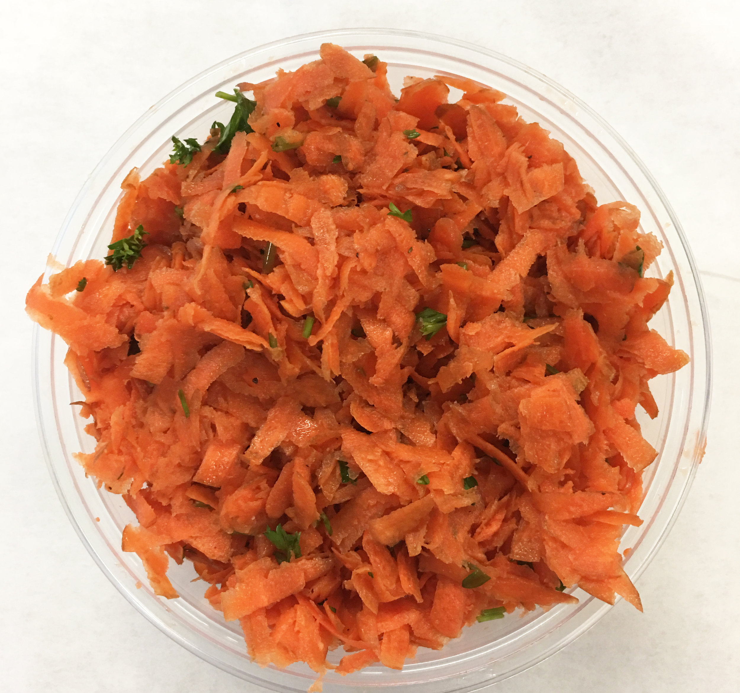 Shredded carrot and scallions with wild kelp (seaweed).