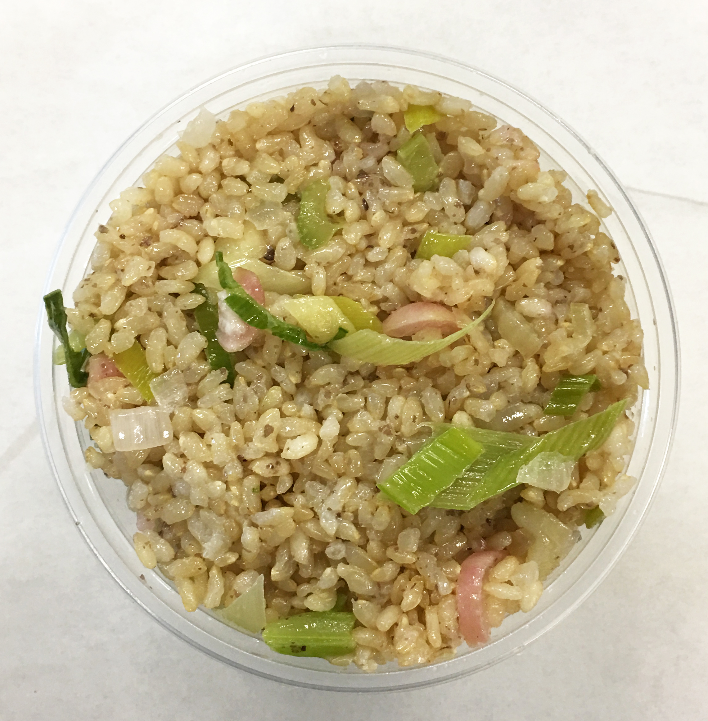 Brown rice stir fry with celery, red radish and leeks.