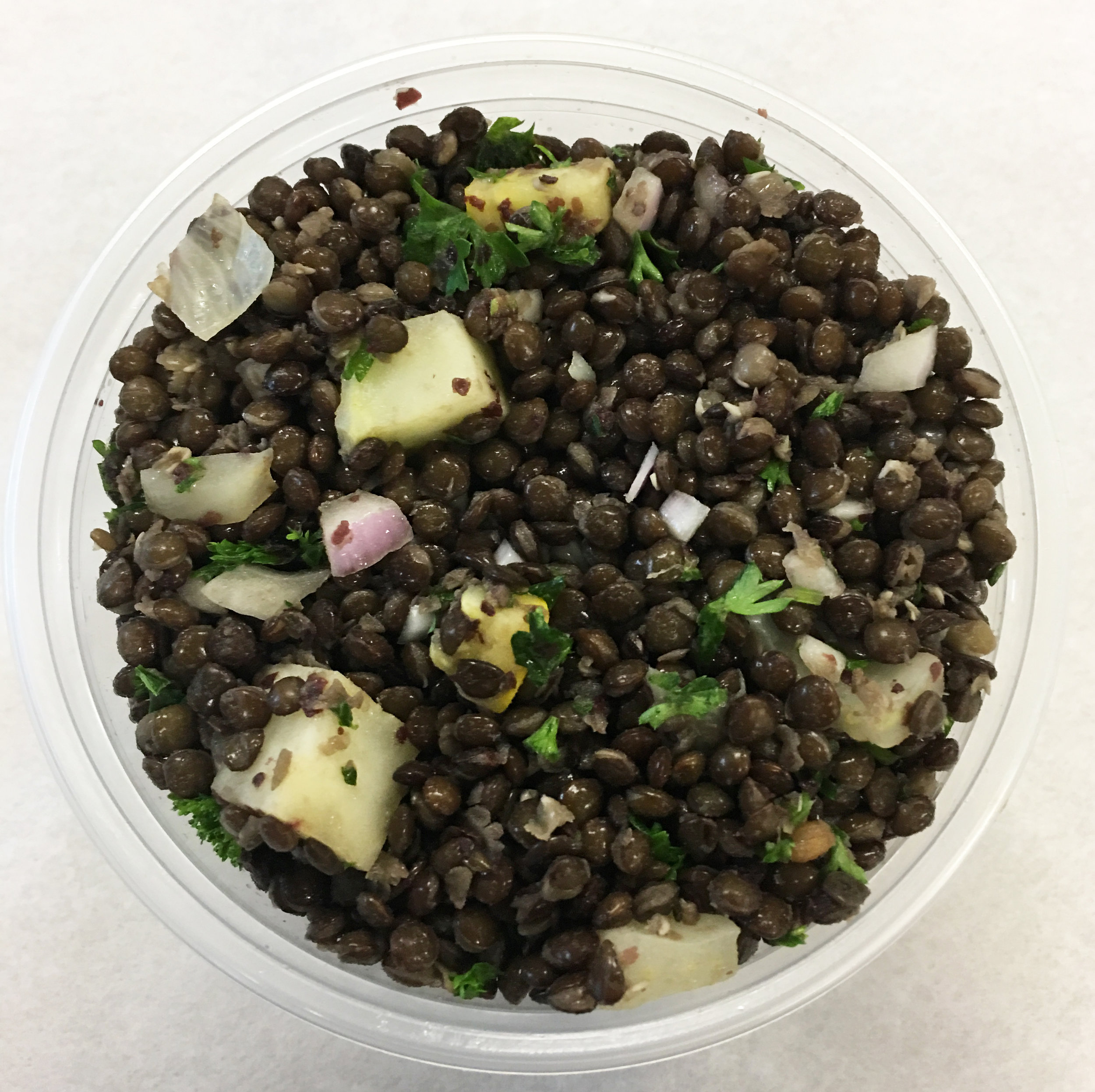 Black lentils with yellow squash, red onion and parsley.