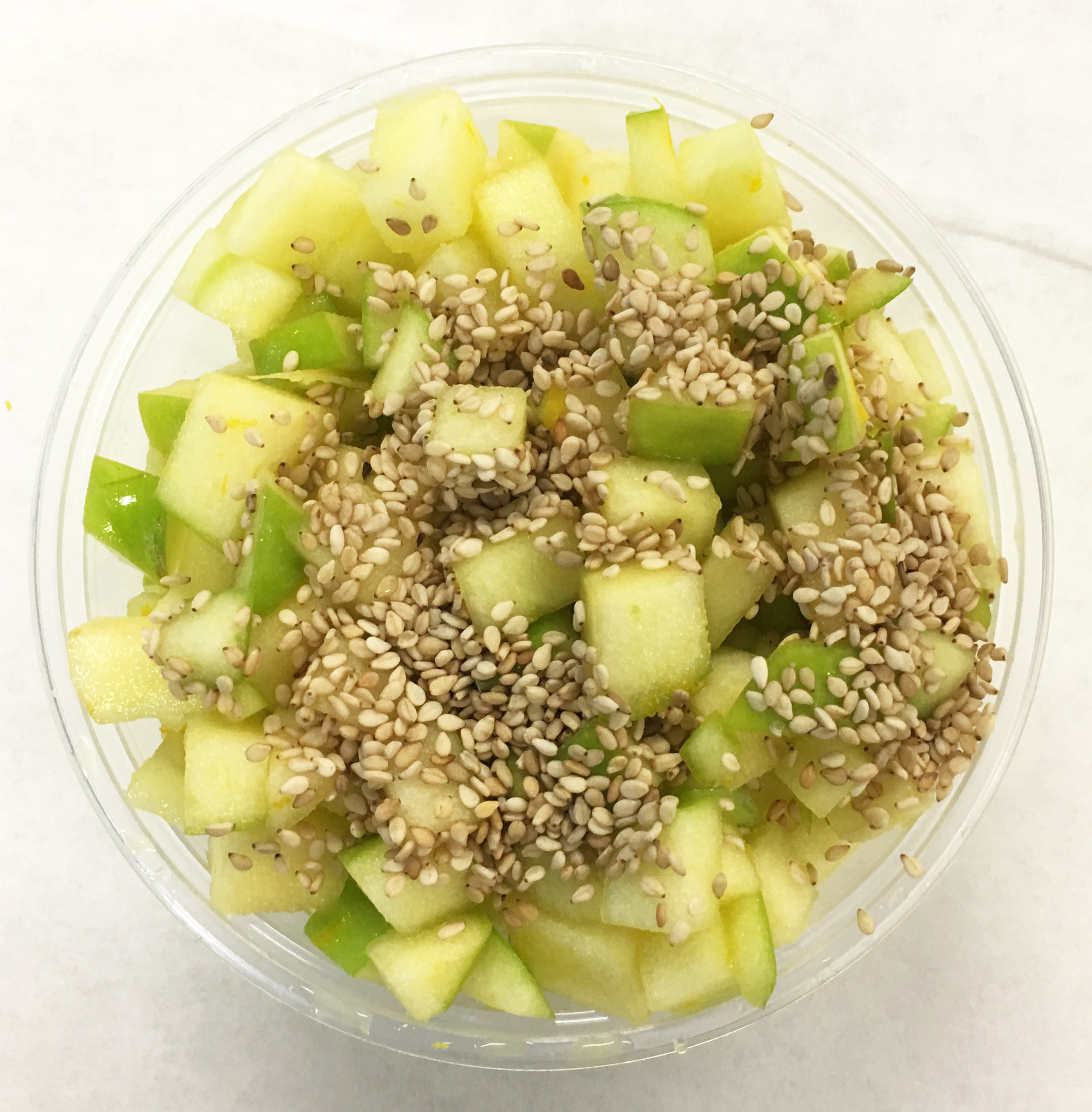 Raw apple ceviche with toasted sesame seeds and a citrus marinade.