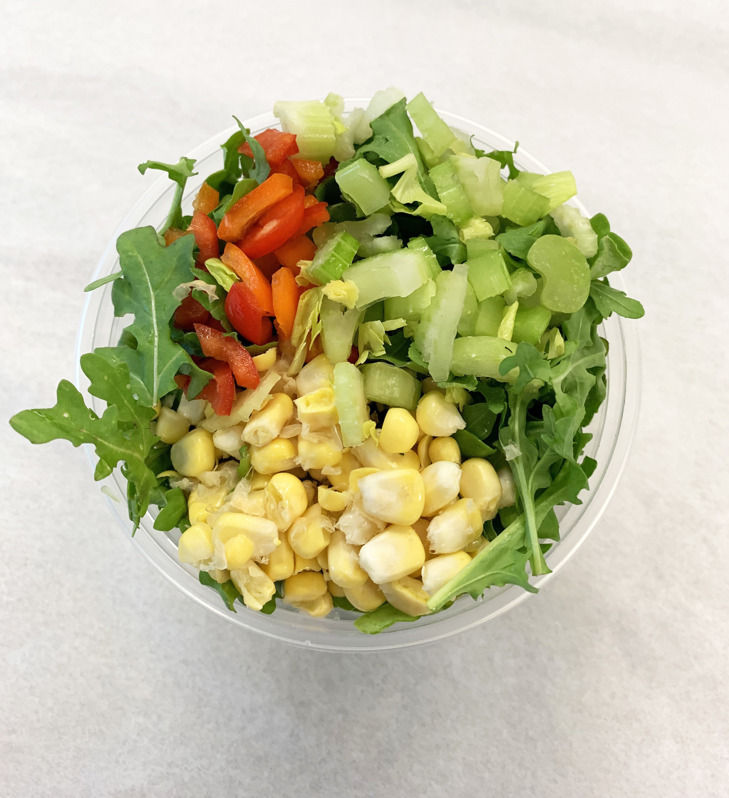 Arugula, fresh corn off the cob, red bell pepper and celery.