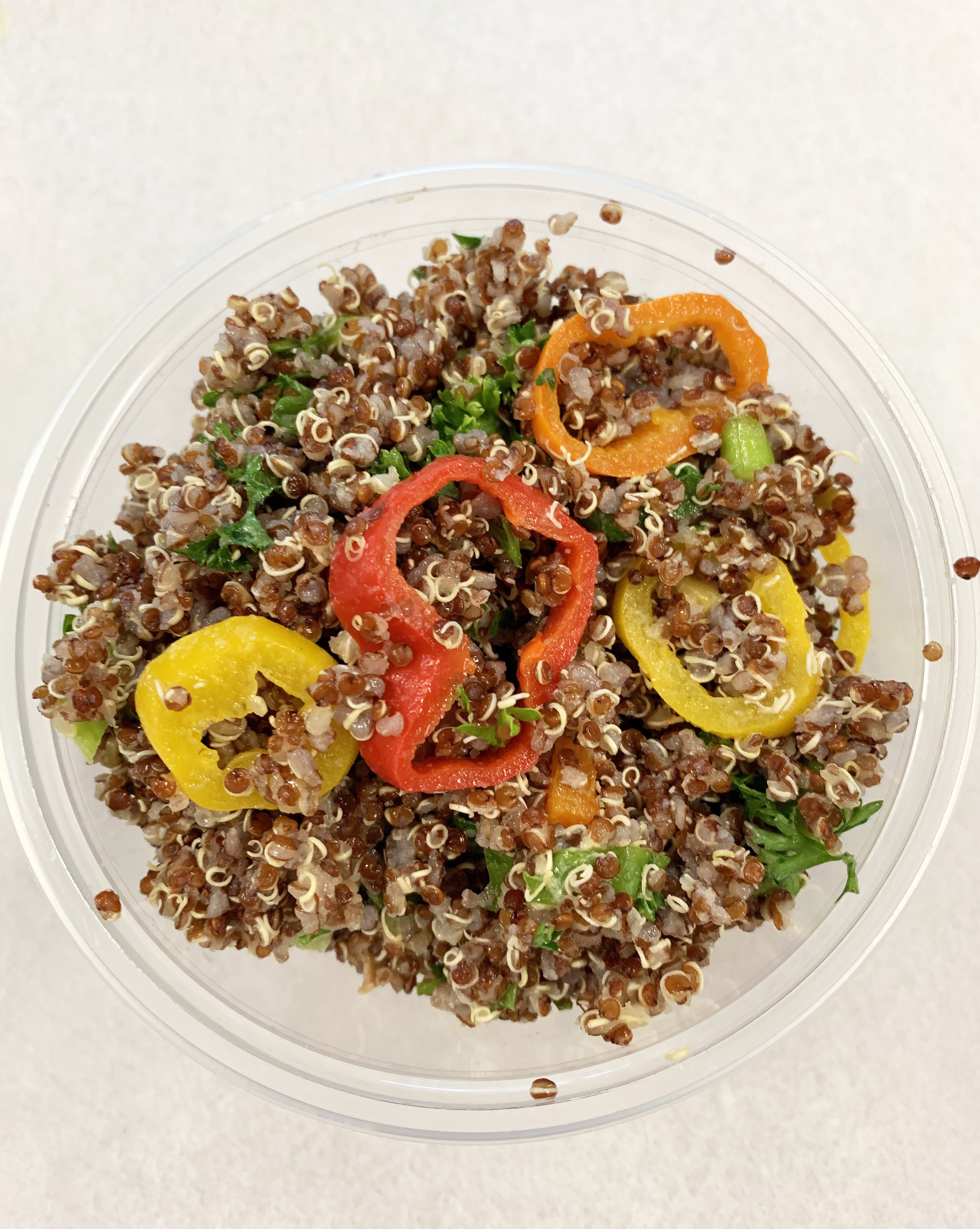 Red quinoa tabouleh with scallions, bell pepper and parsley.