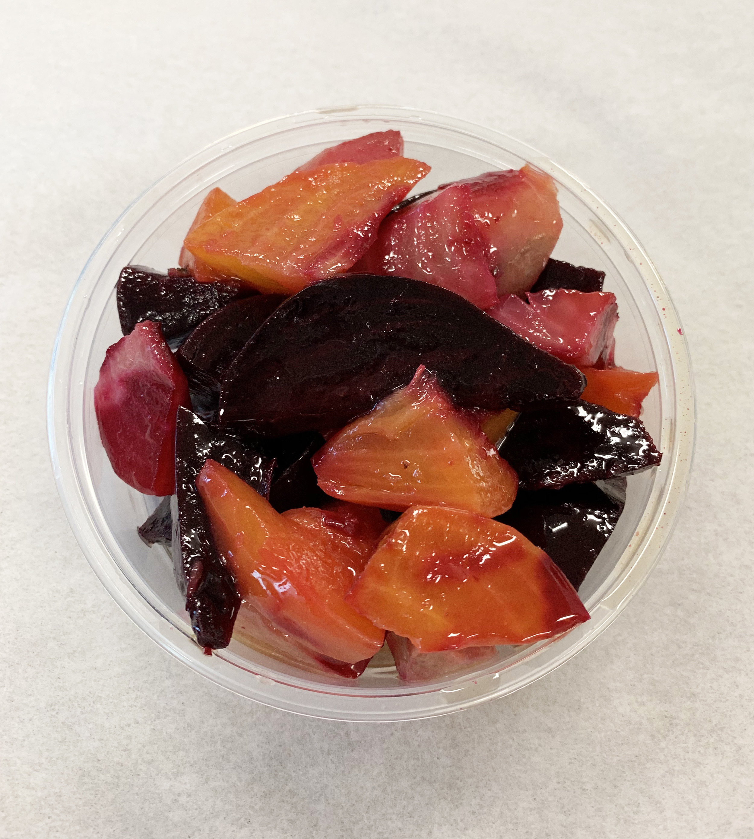 Steamed multicolored beets with olive oil and salt.