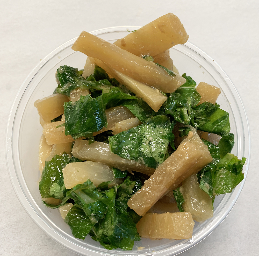 Daikon with greens sautéed in miso and umeboshi vinegar.