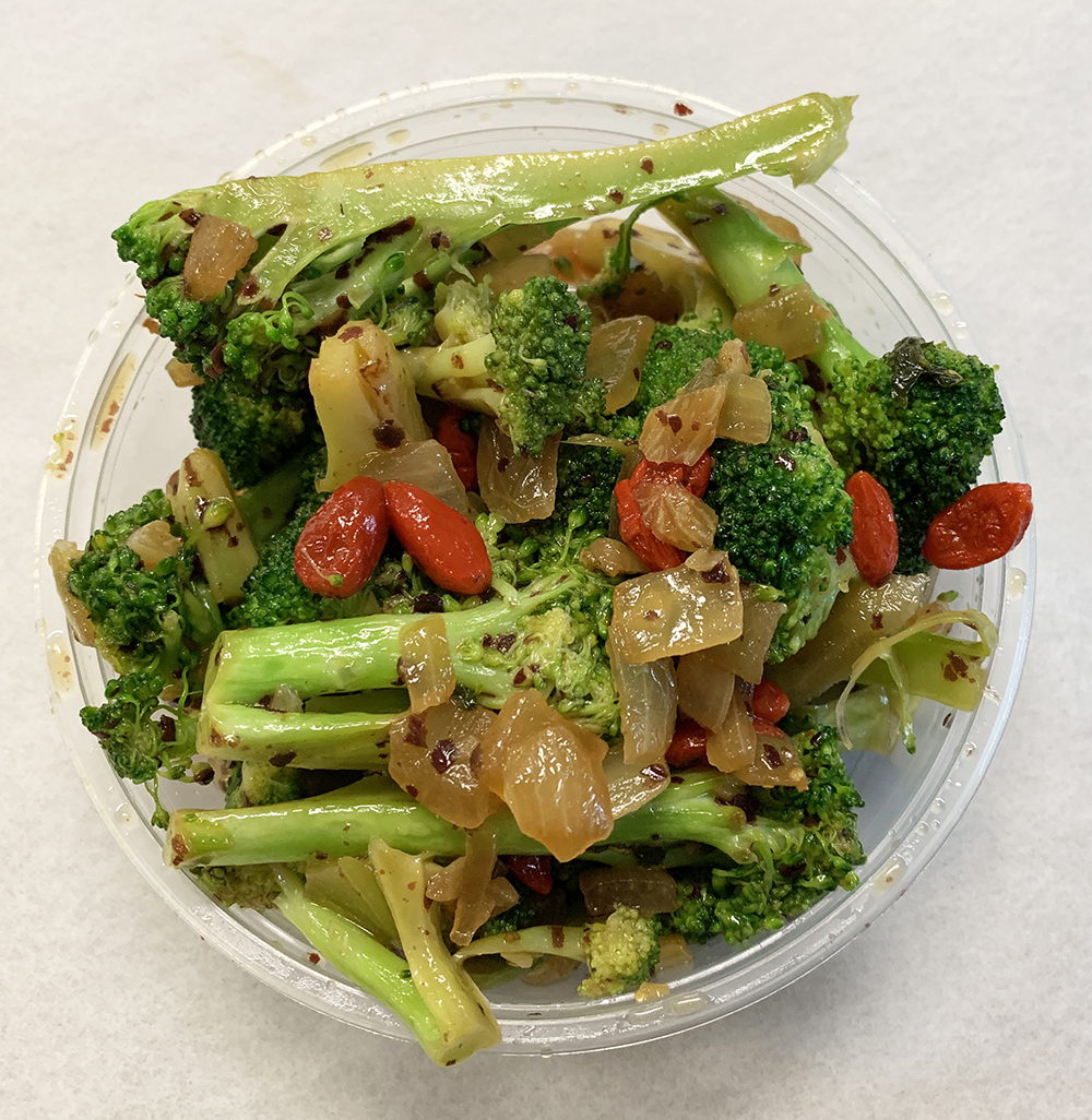 Sautéed broccoli with onions, garlic and goji berries.