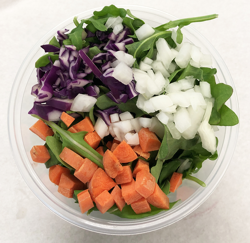 Arugula, red cabbage, carrot and onion.