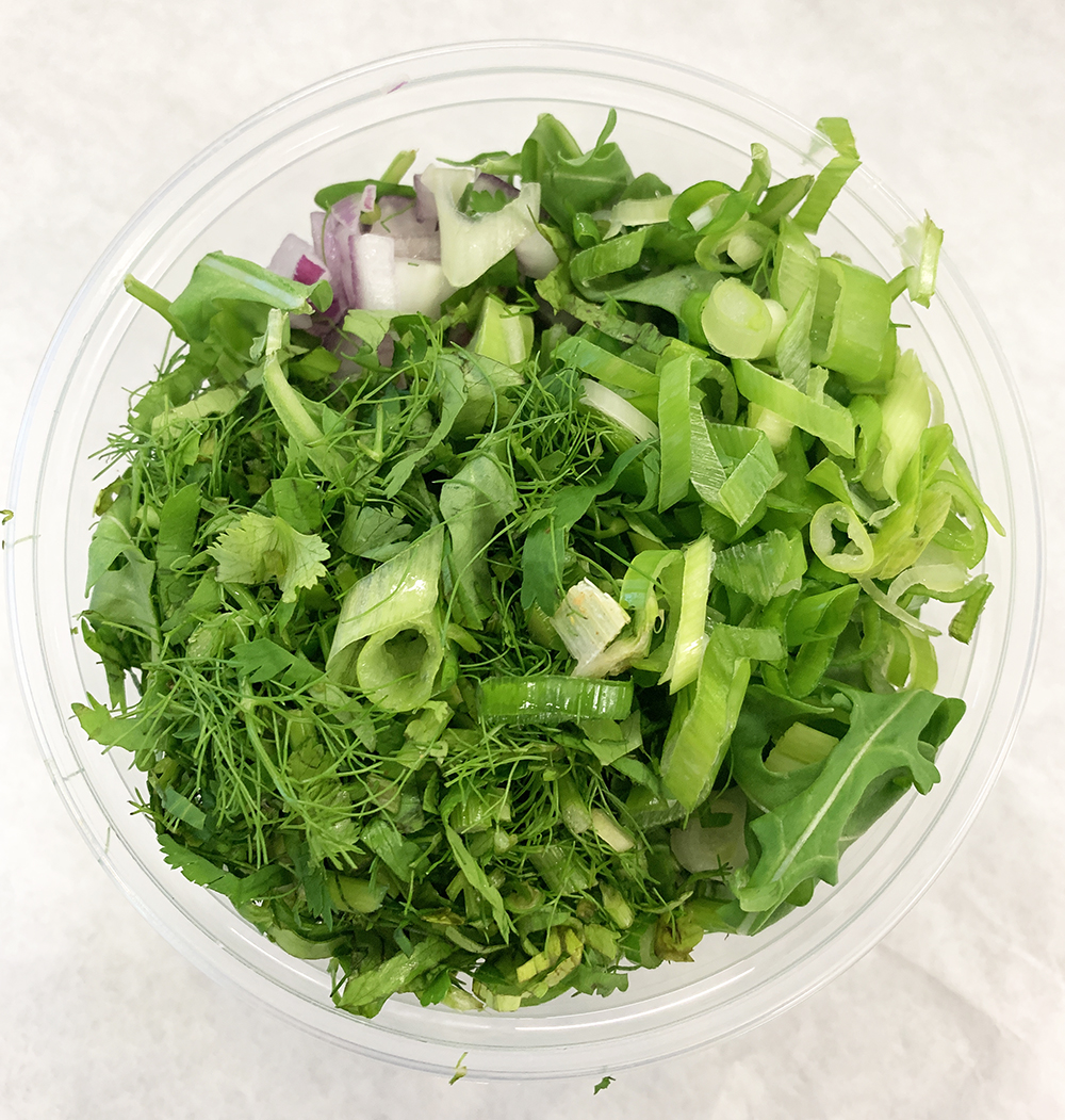Arugula salad with scallion, fennel fronds and red onion.