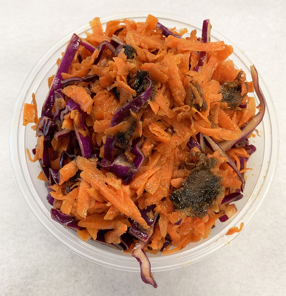 Carrot and red cabbage slaw with tangerine vinaigrette.