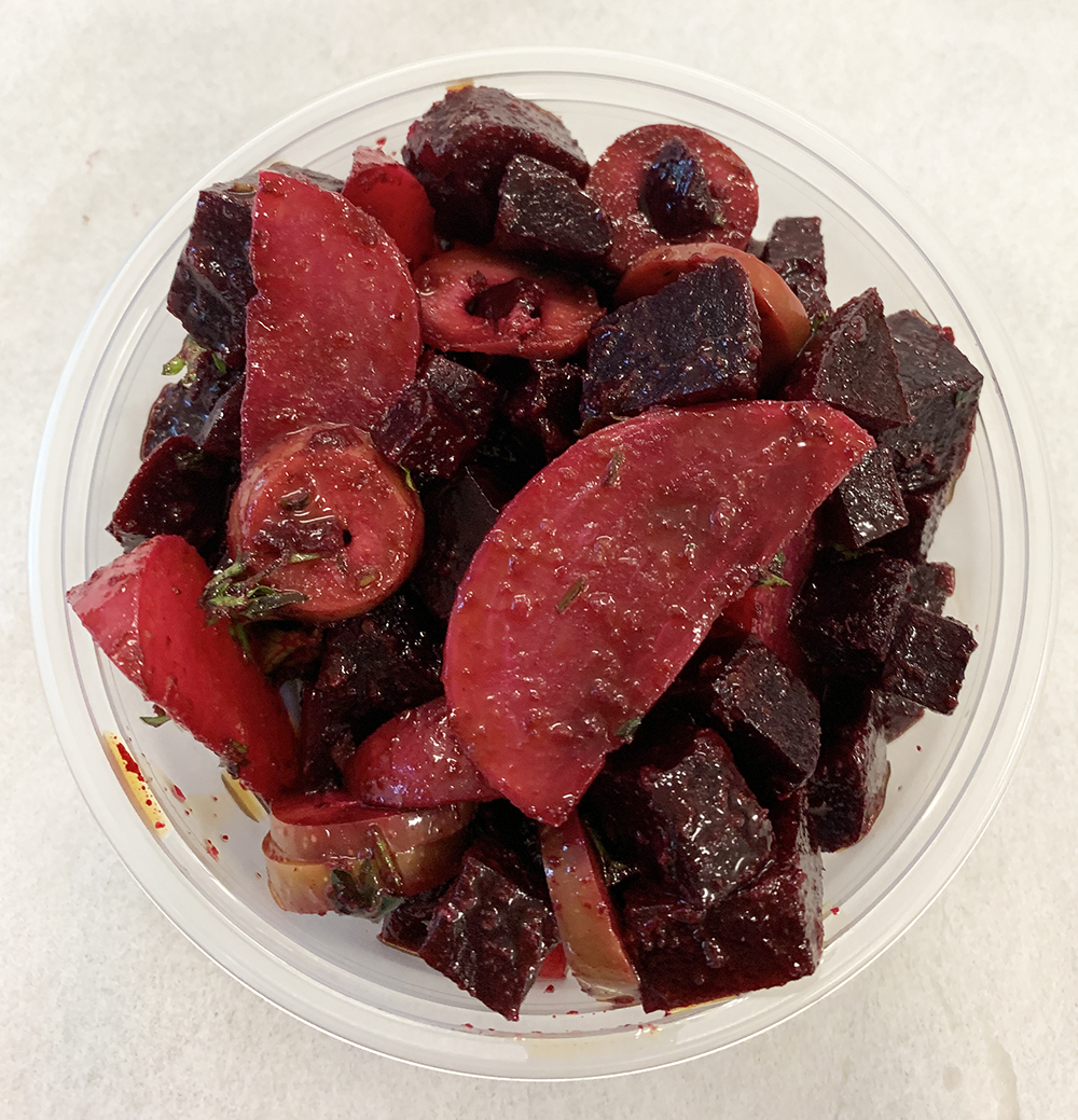 Blanched beet and radishes with green olives and a sun dried tomato sauce.