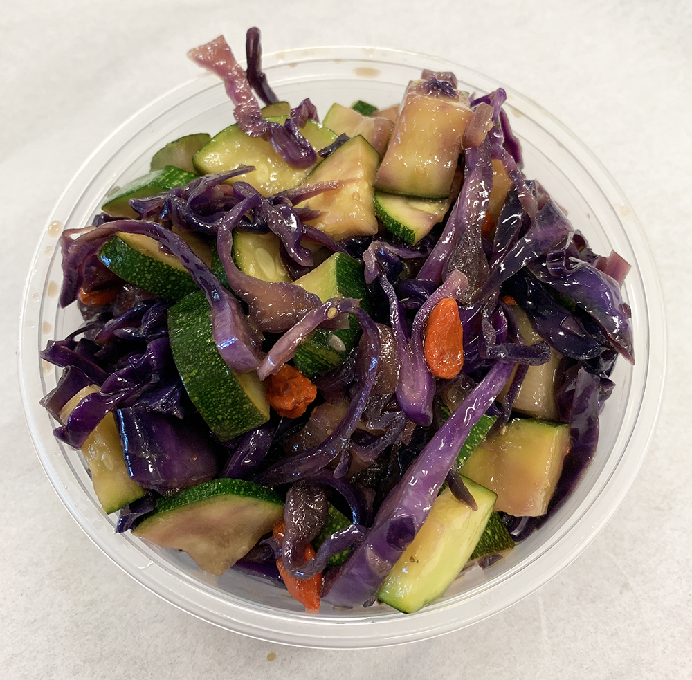 Sautéed zucchini and red cabbage with goji berries.