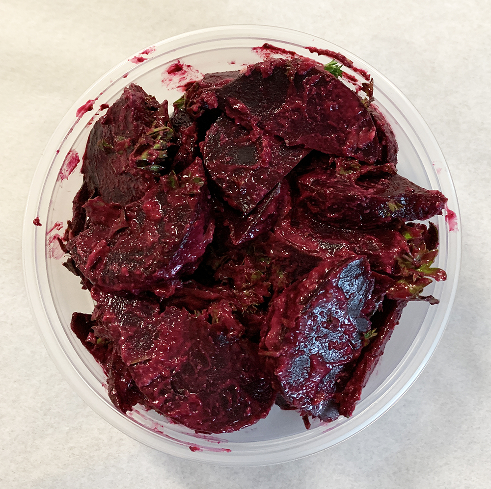 Steamed beets with tahini and parsley dressing.