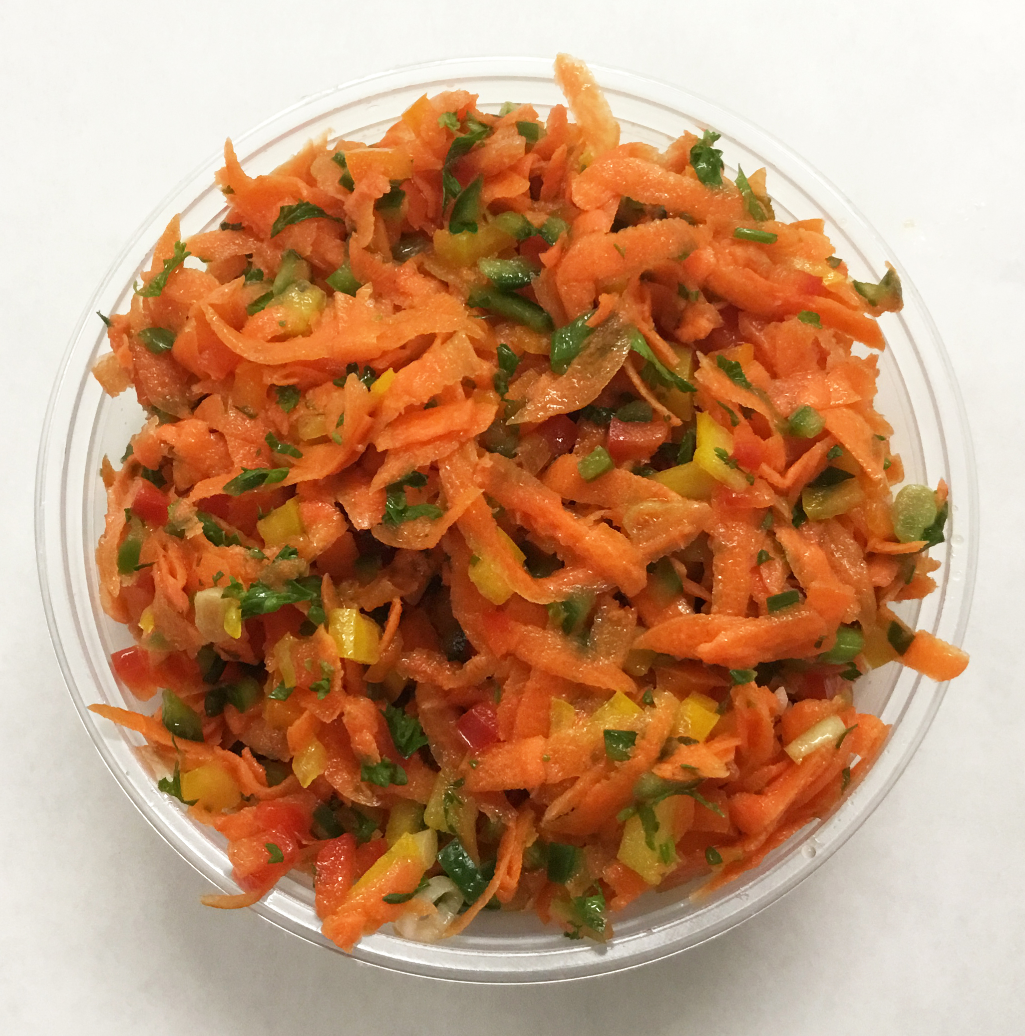 Carrot salsa with bell, Seranno and Anaheim peppers, scallions, apple cider vinegar and fresh squeezed orange juice.
