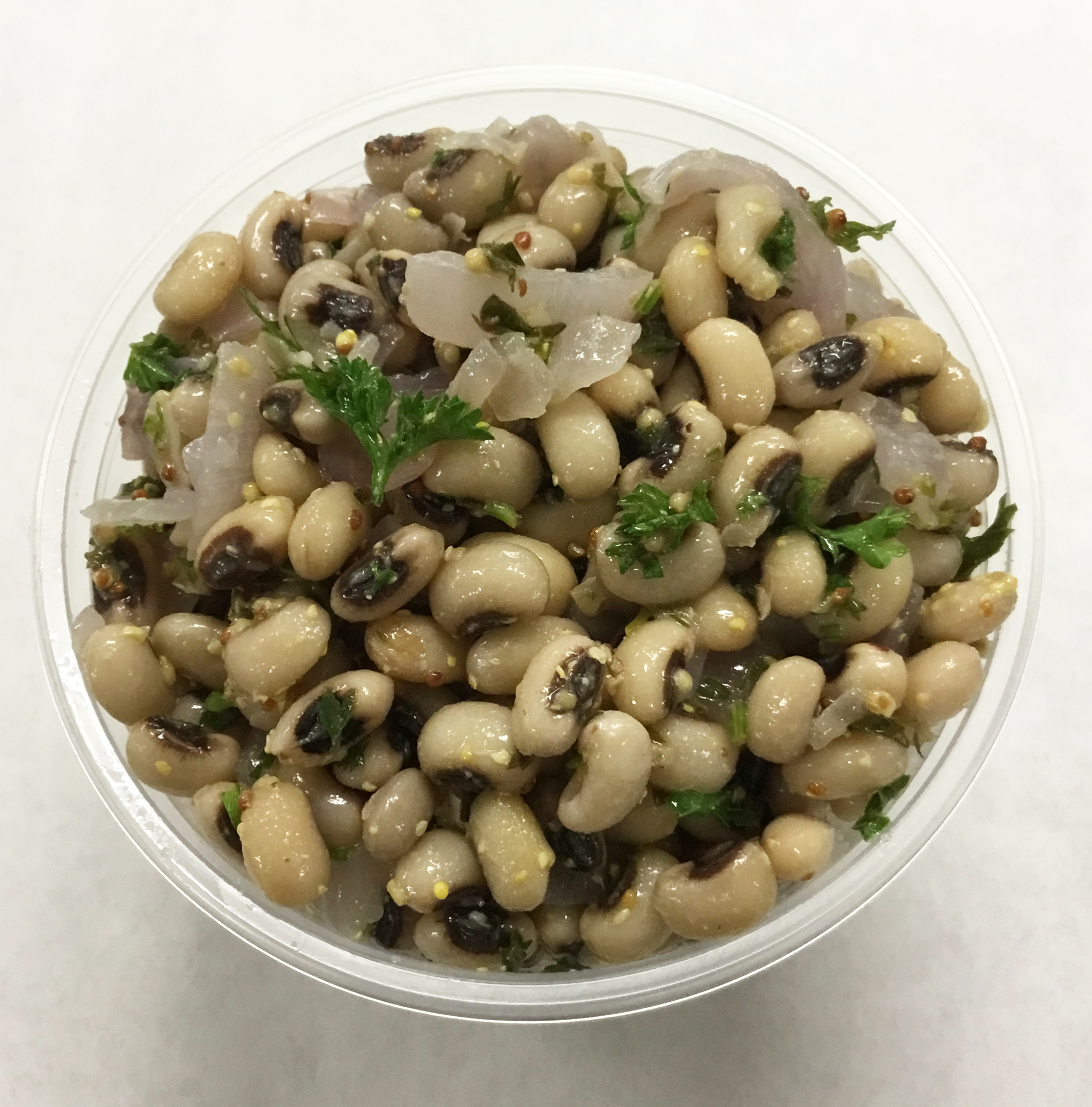 Black eyed peas with red onion, parsley and a French vinaigrette dressing.