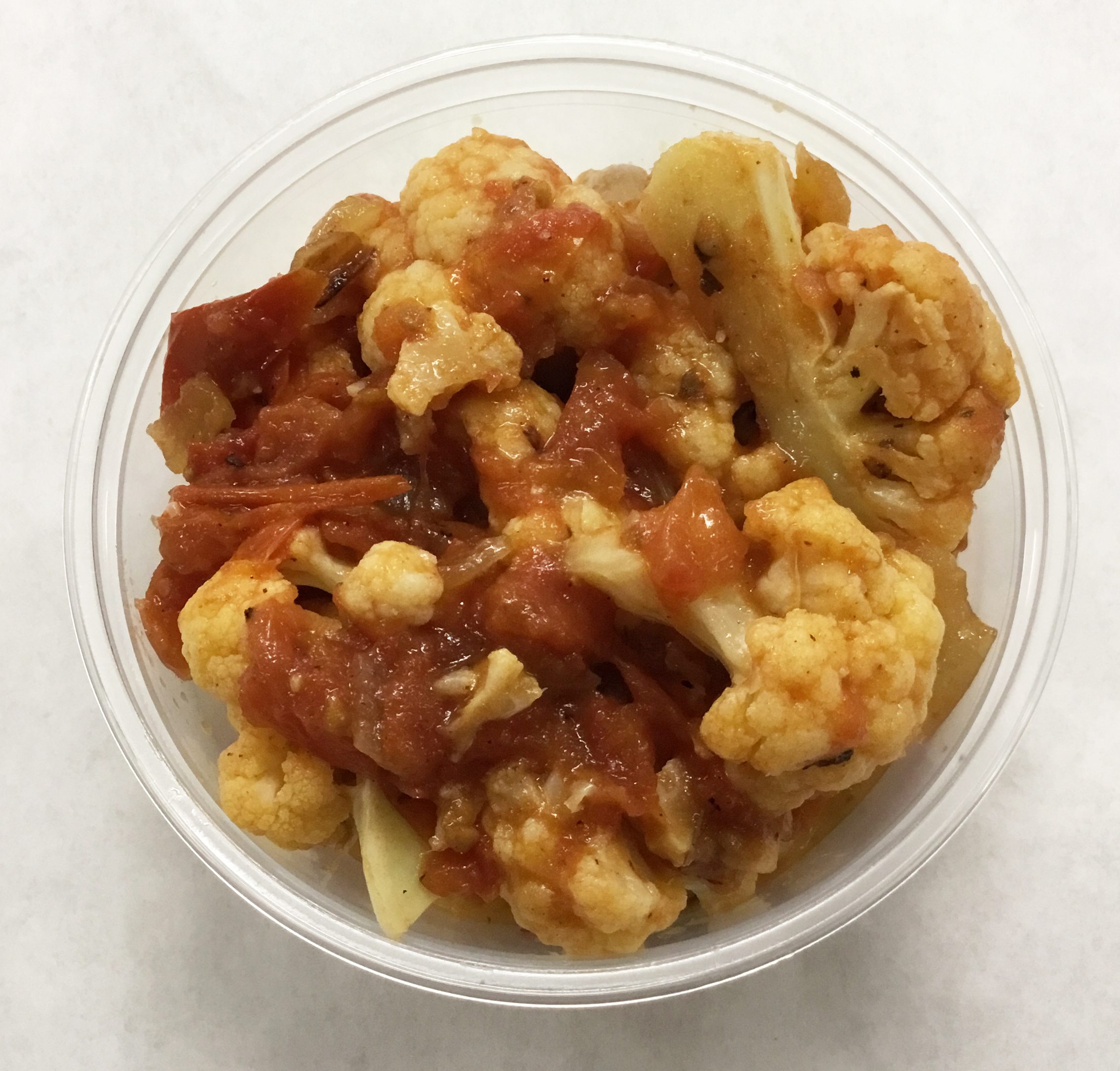 Cauliflower provencal with tomato, garlic, onion and basil.