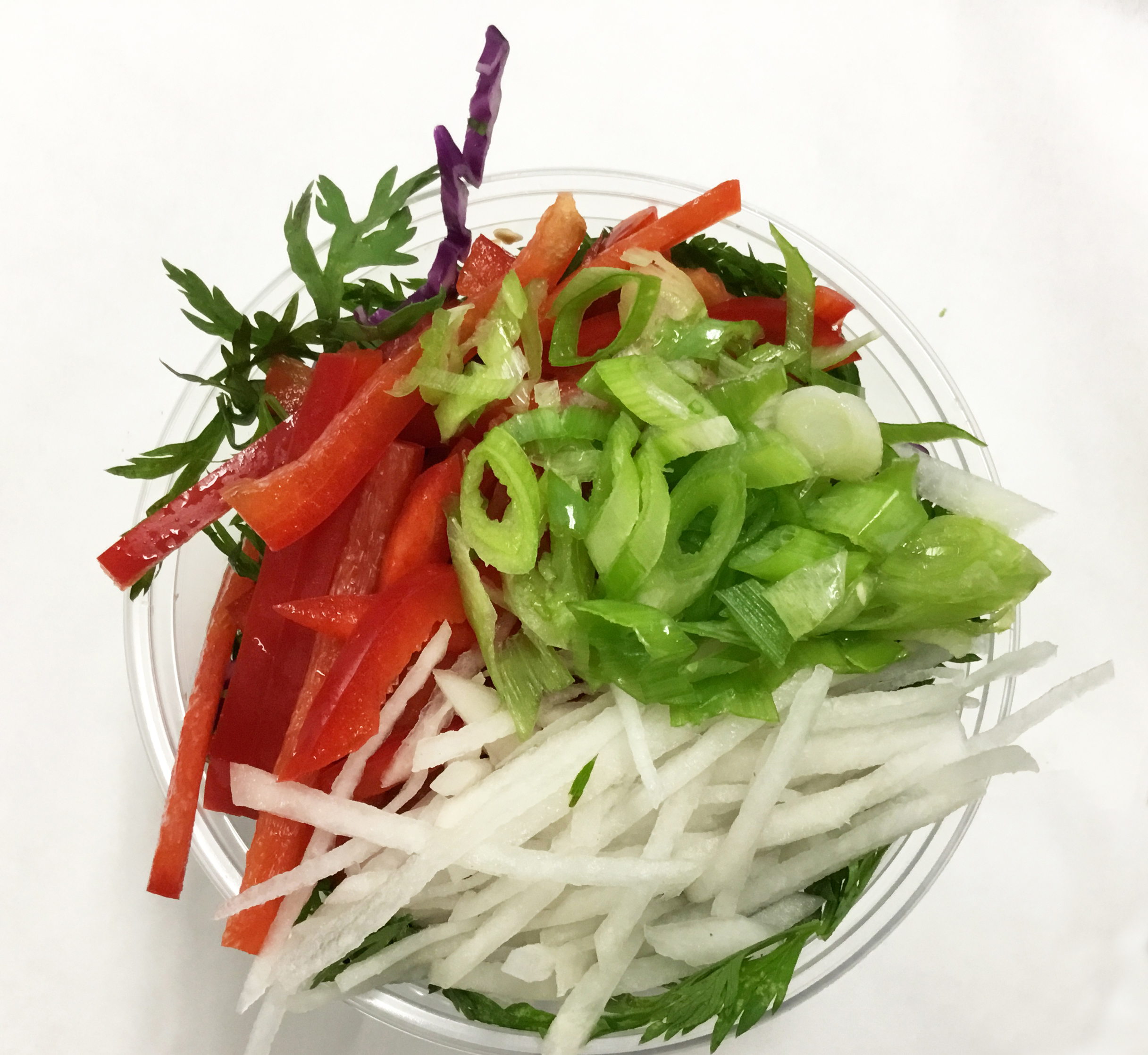 Red cabbage, red bell peppers, scallions, daikon radish and carrot tops.