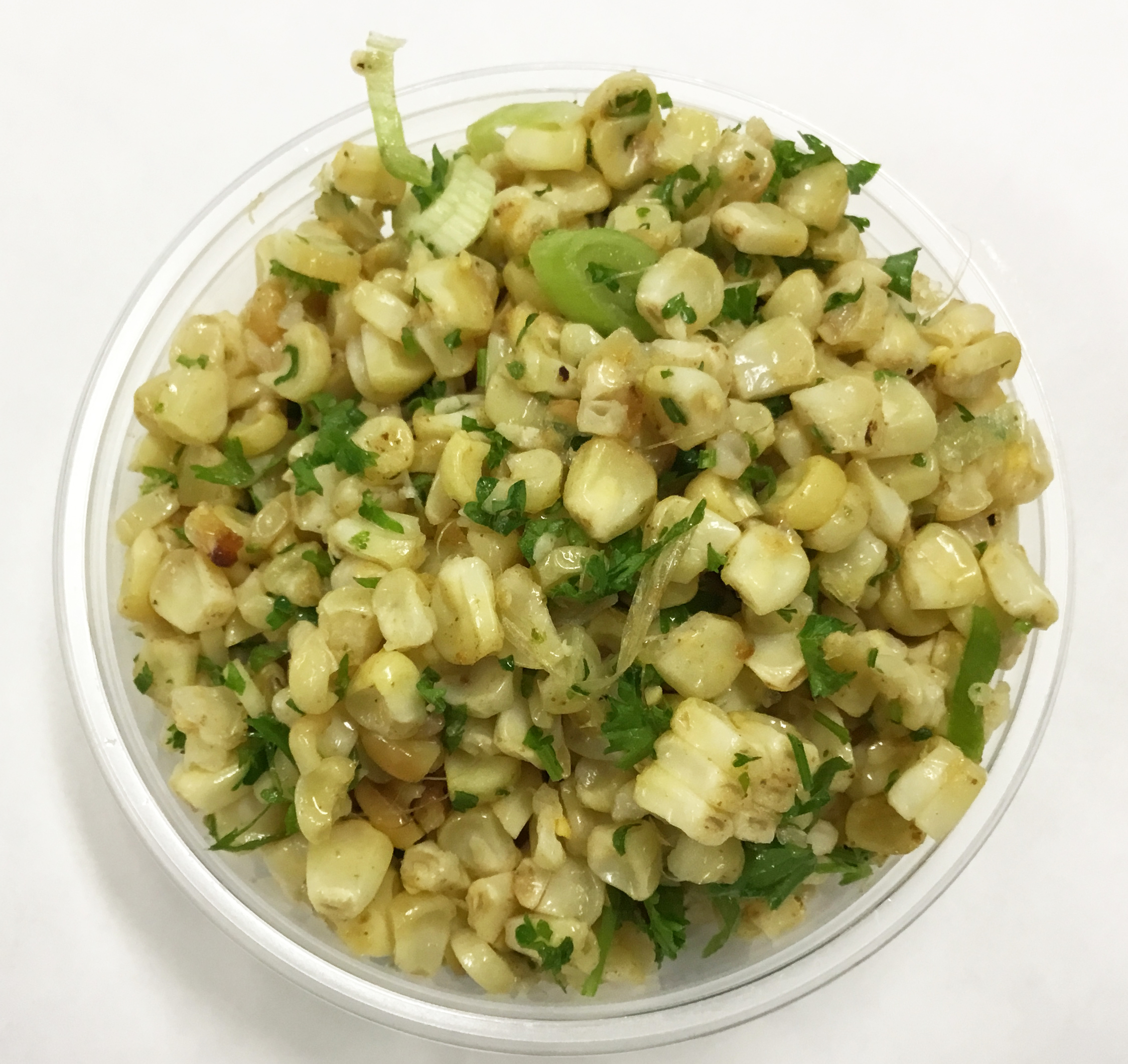 Fresh roasted corn salad with parsley, scallions and garlic.