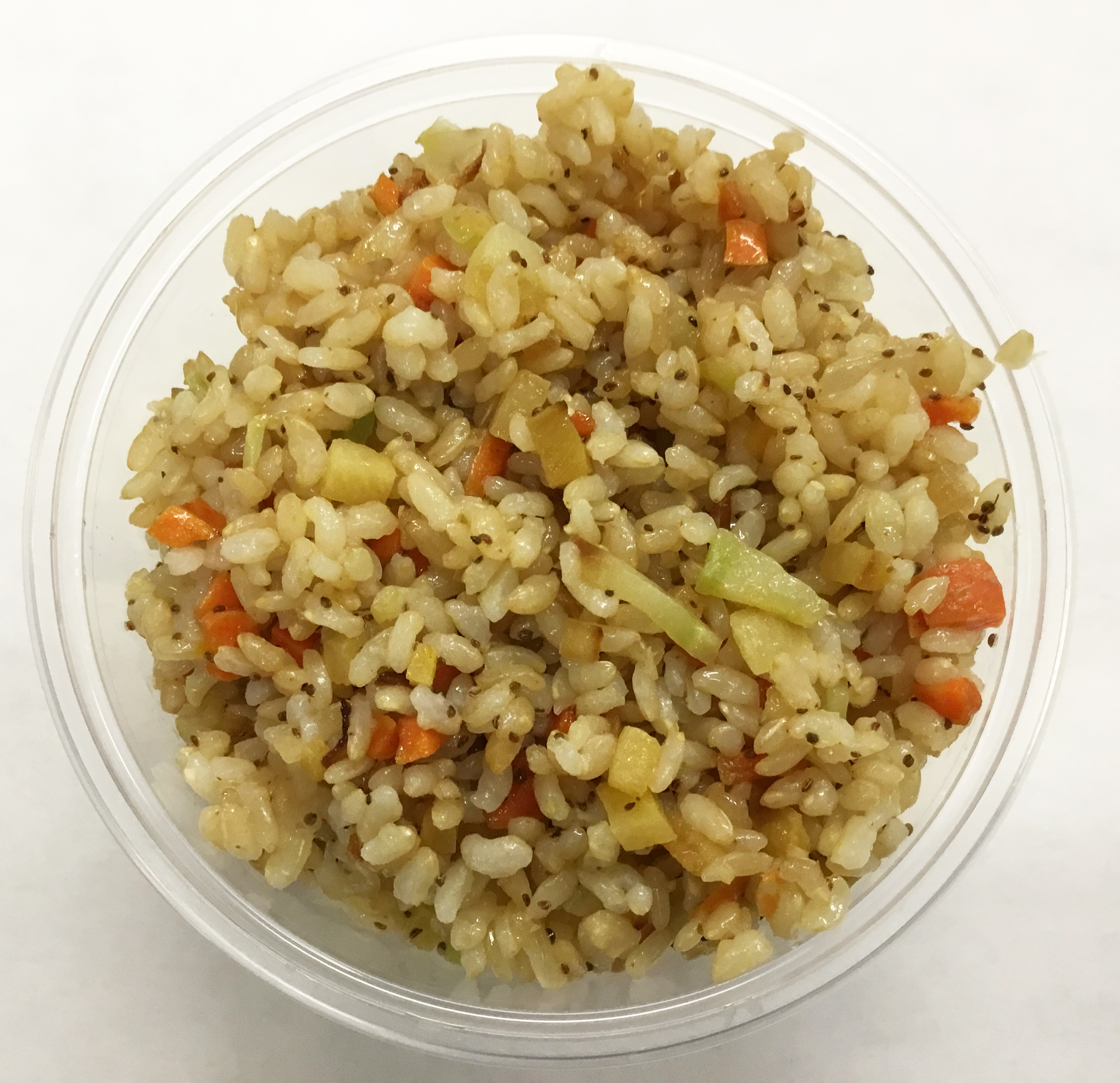Stir fried brown rice with rutabaga, carrot, onion, broccoli stems and celery seeds.