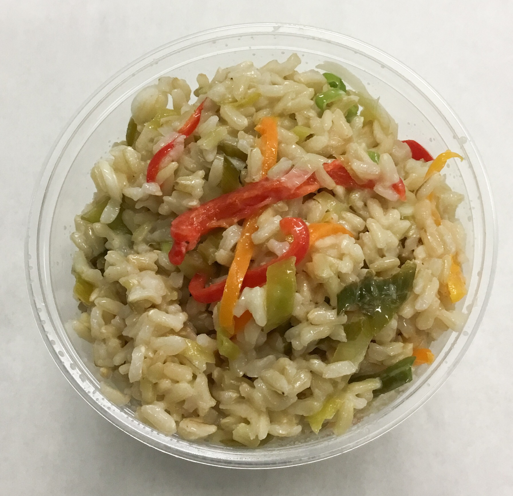Brown basmati rice salad with bell peppers, leeks, scallions, white miso and yuzu.