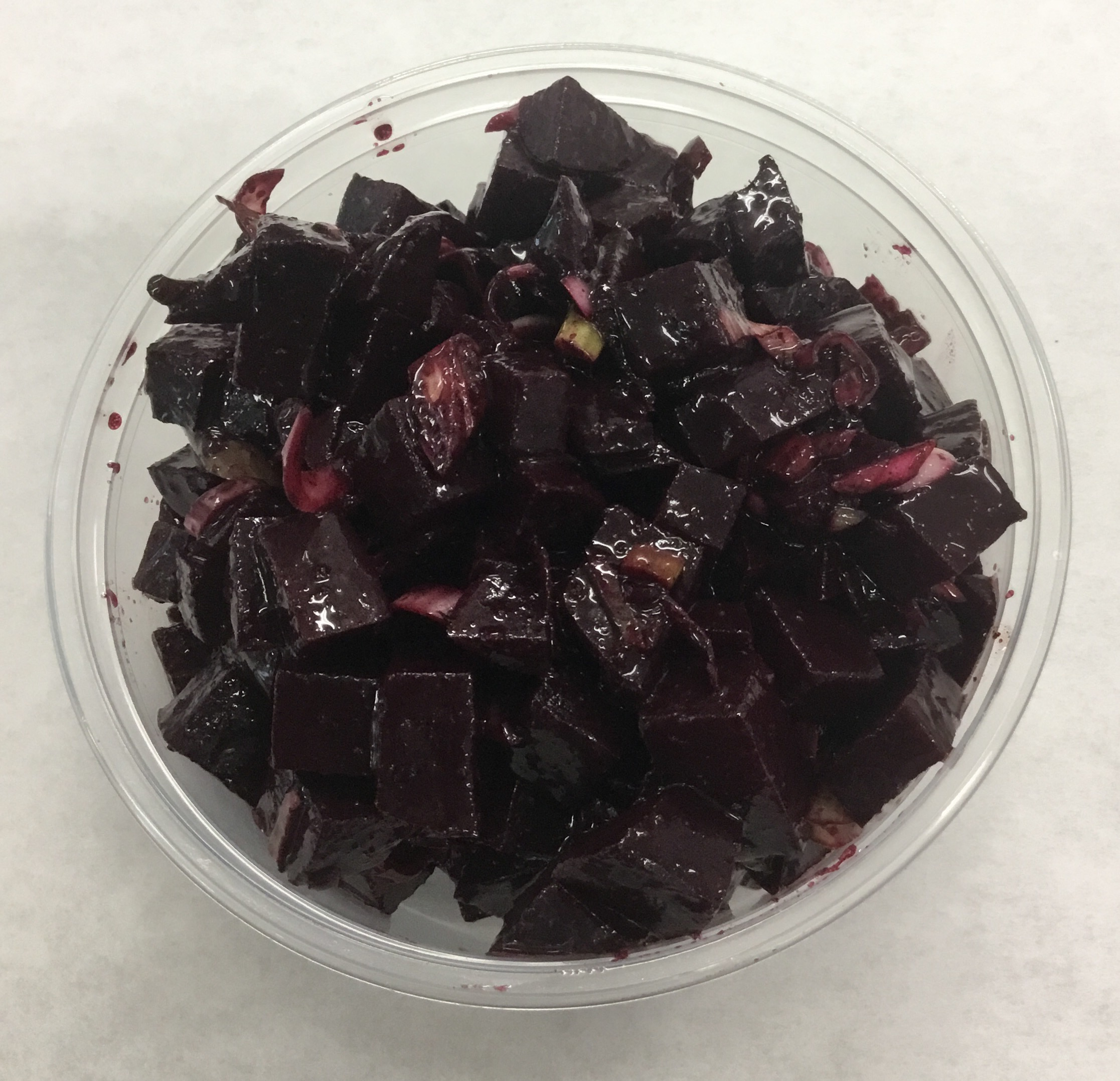 Red beets and scallions with black sesame seed and chipotle dressing.