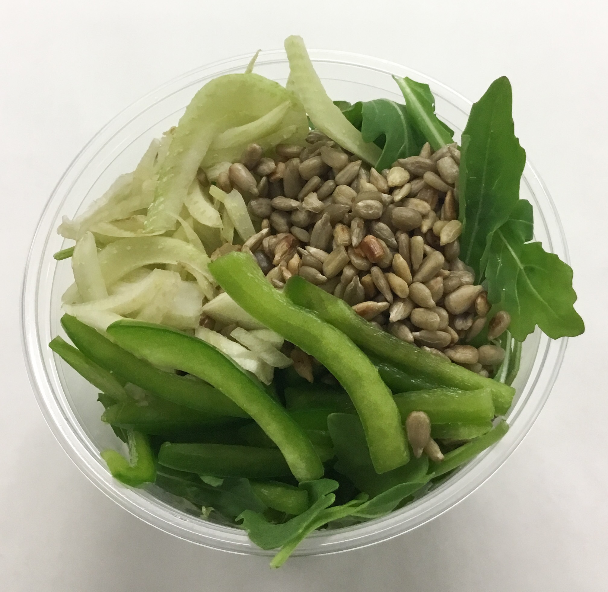 Arugula with fennel, green peppers and fresh roasted sunflower seeds.