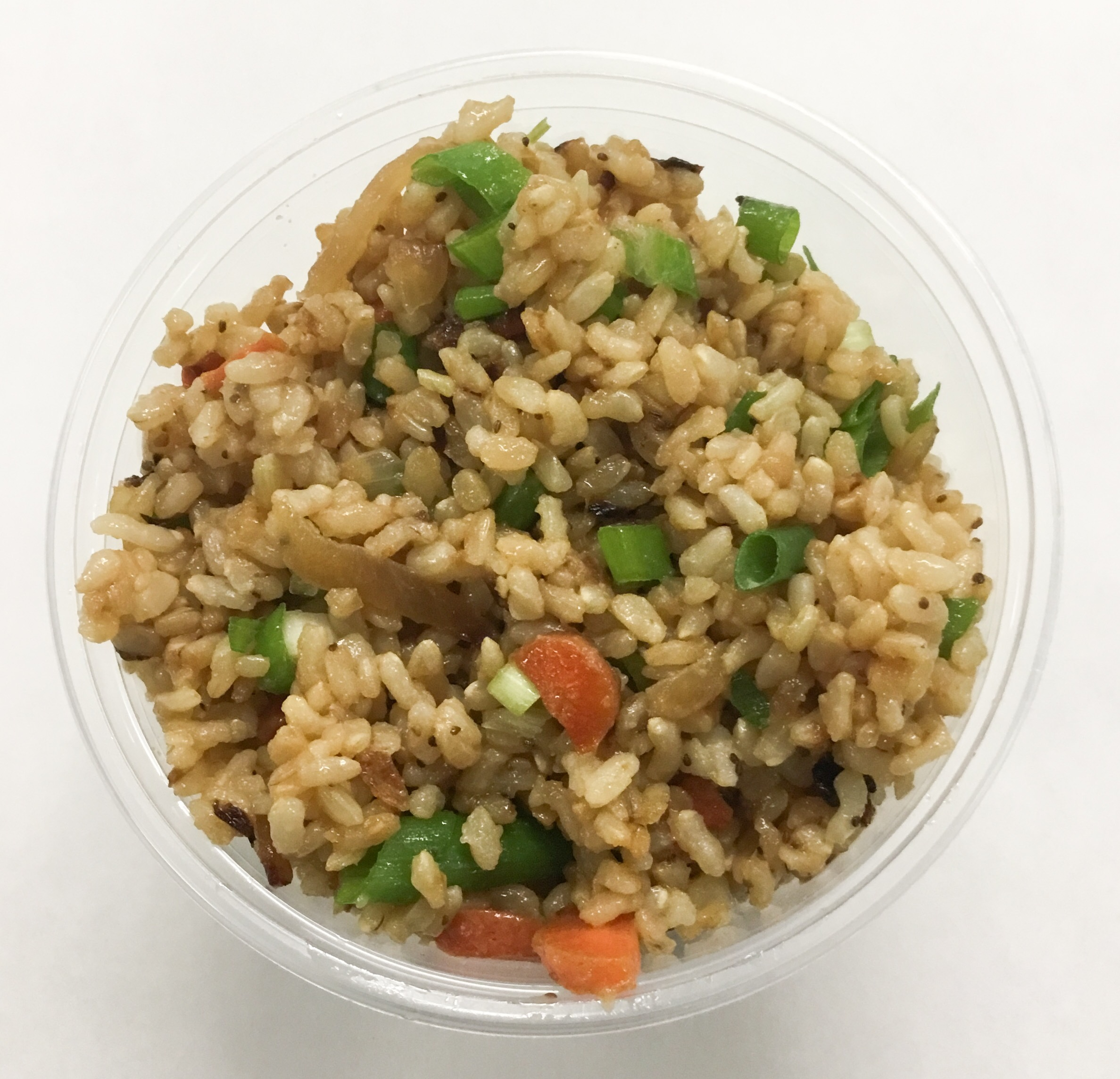 Stir fried brown rice wit onion, carrot and scallions.