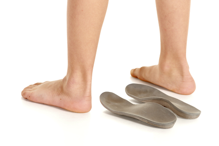 99780730_S_teenager_child_severs_disease_heel_pain_orthotics_standing_feet.jpg