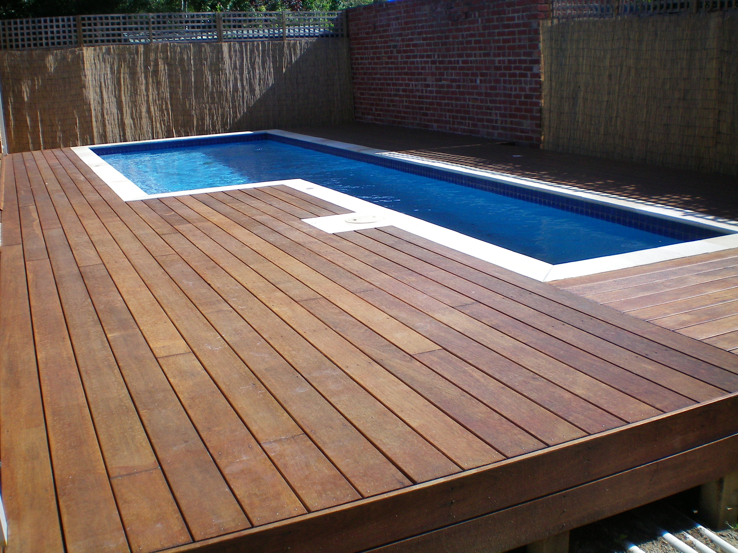 21-attractive-wooden-deck-design-of-swimming-pool-aida-homes-nice-above-ground-swimming-pool-designs.jpg
