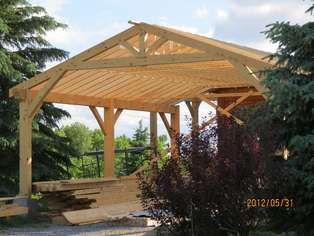 Carport is now taking shape with the roof trusses in place