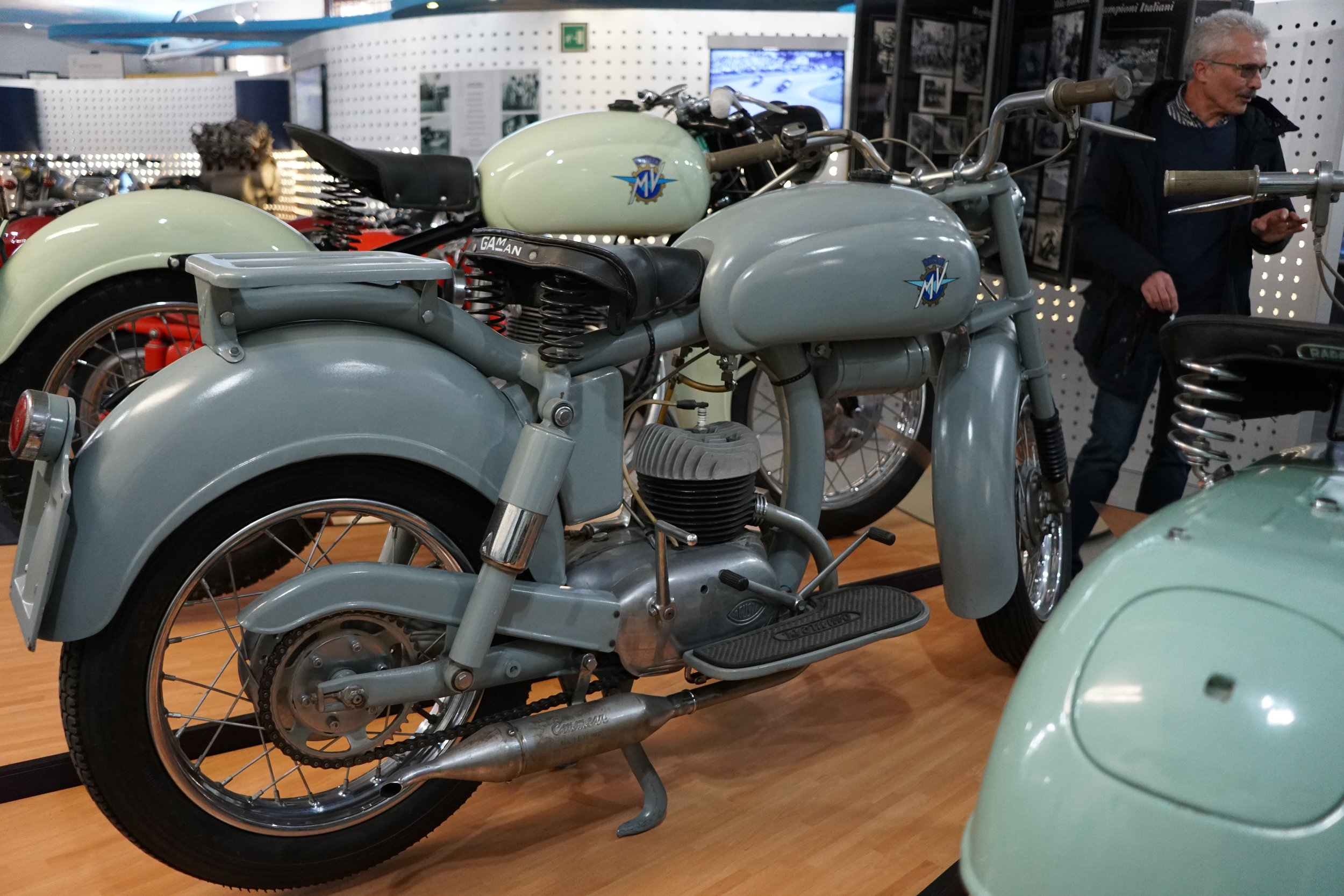 1955 prototype 125cc 'Pullman'. 125cc, 2-stroke, 3 speed. This was a commercially successful road bike. MV Agusta sold 9,000 units with a twistgrip gear shift in 1953, then 27,000 units with foot shift over the next two years.
