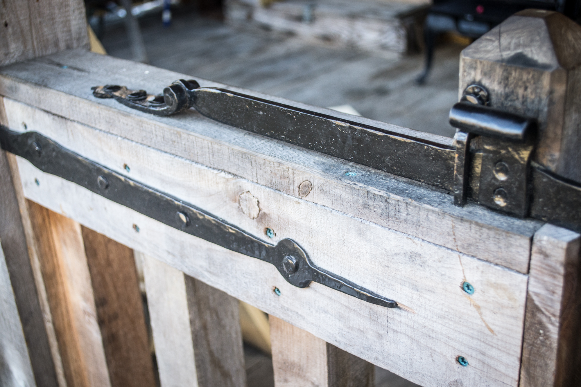 The latch bar is heavy to help make the action of the latch faster, and mounted on the outside of the gates to help contain very small children.
