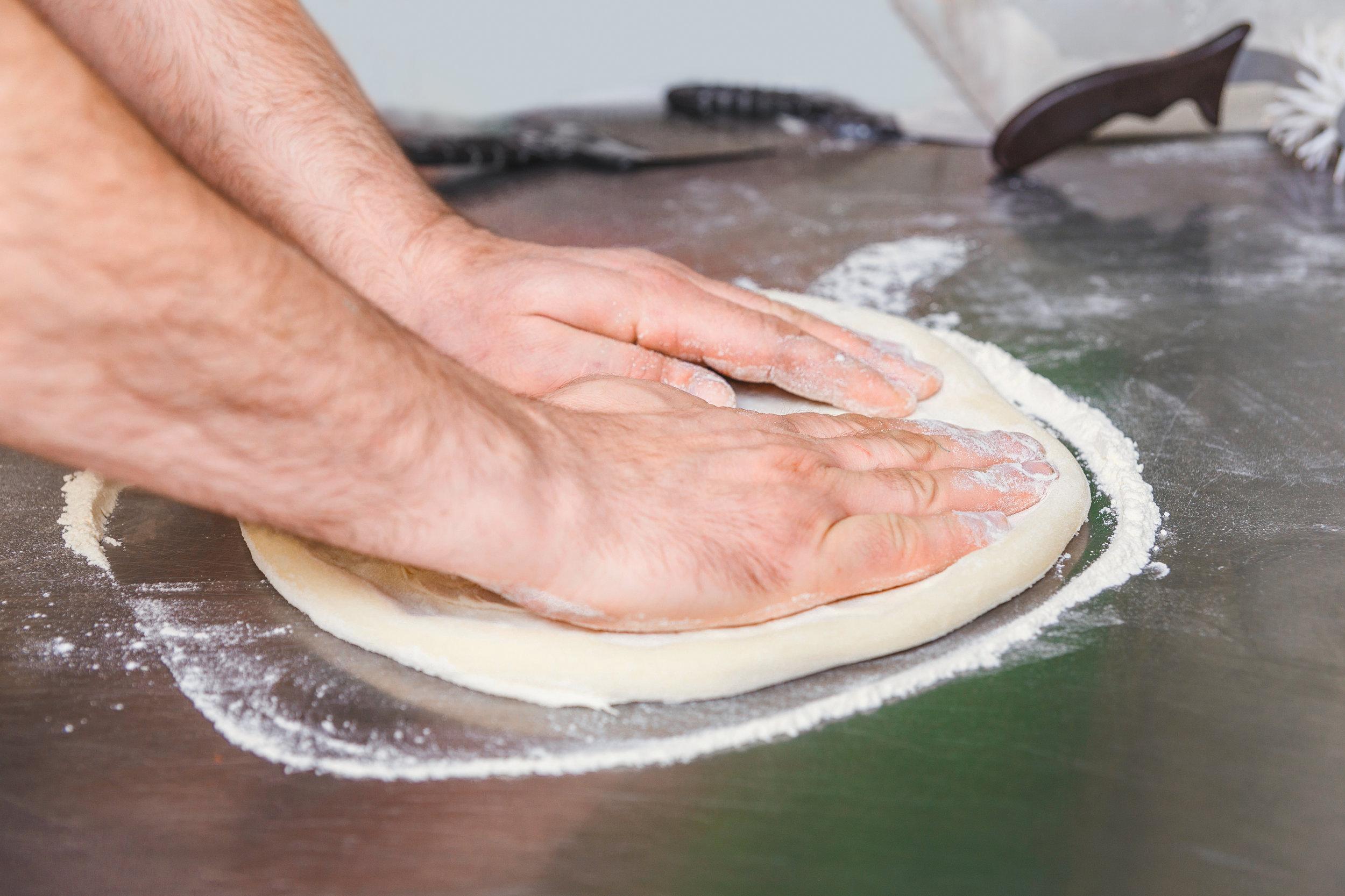 bigstock-Cook-Forms-A-Dough-Pizza-Base-173400365.jpg