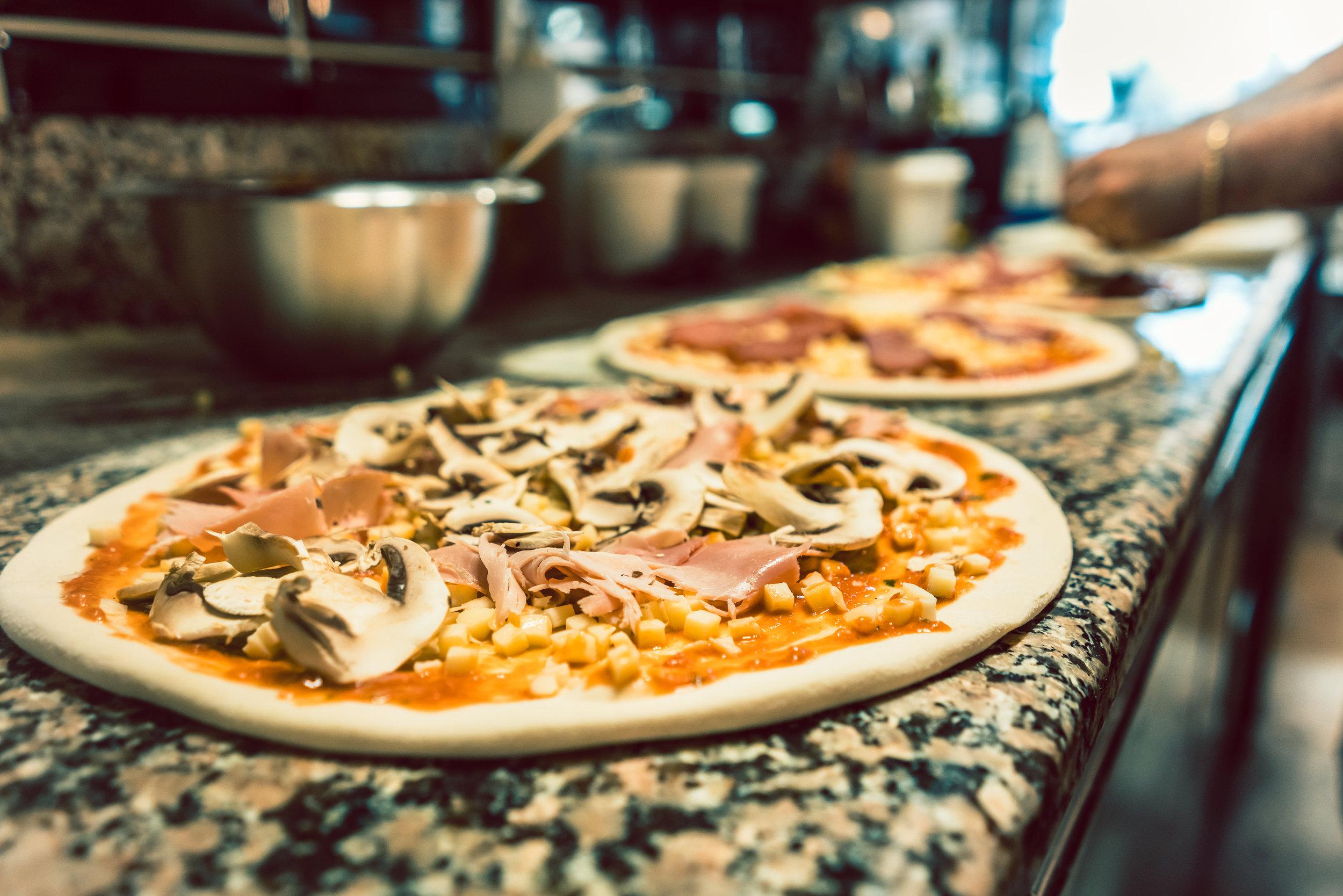 bigstock-Close-up-of-unbaked-pizza-doug-241154497 (1).jpg
