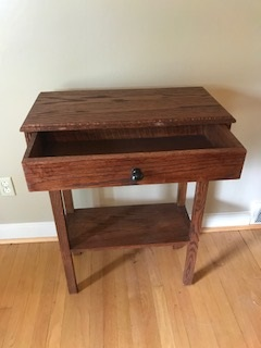 Oak phone book desk - This desk/table has a deep free sliding drawer as well as a shelf great for storage.
