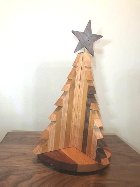 Christmas tree Decoration - This tree was made from Cherry, oak, Black Walnut, and Mahogany. This base of this tree is on a revolving track which allows you to spin the tree.