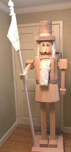 Nutcracker - Custom built nutcracker with working and moving jaws and arms. The flag he is holding was made of tanned deer hide and the customers name burned into the hide. This was made of Oak and Black Walnut.