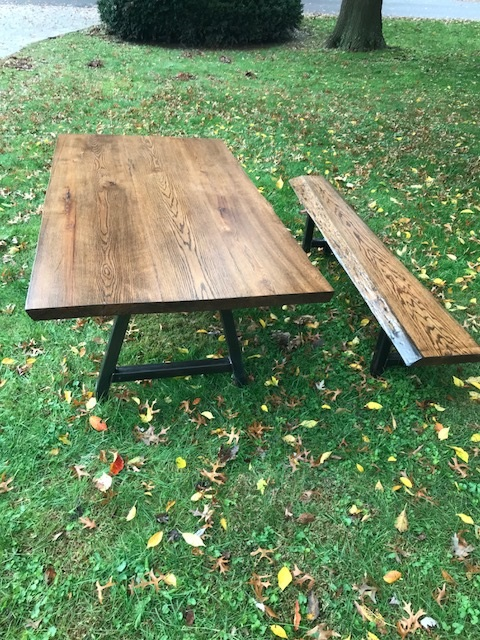 "Live Edge Oak Table - This was made from Oak with 2"" steel tubing legs. This table measures 7' by 4' and comes with a live edge bench with matching steel tubing legs. This table was stained with a Minwax Jacobean stain."