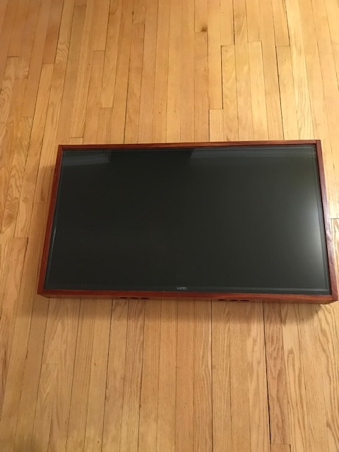 Bloodwood TV shadow box - This TV has been set with a clear plexiglass top with bloodwood frame