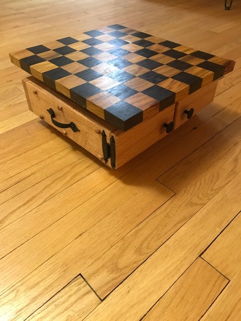 Chess Board - The board is made of Canarywood and Wenge hardwoods. It has a rotating top with oak storage compartment for the game pieces.