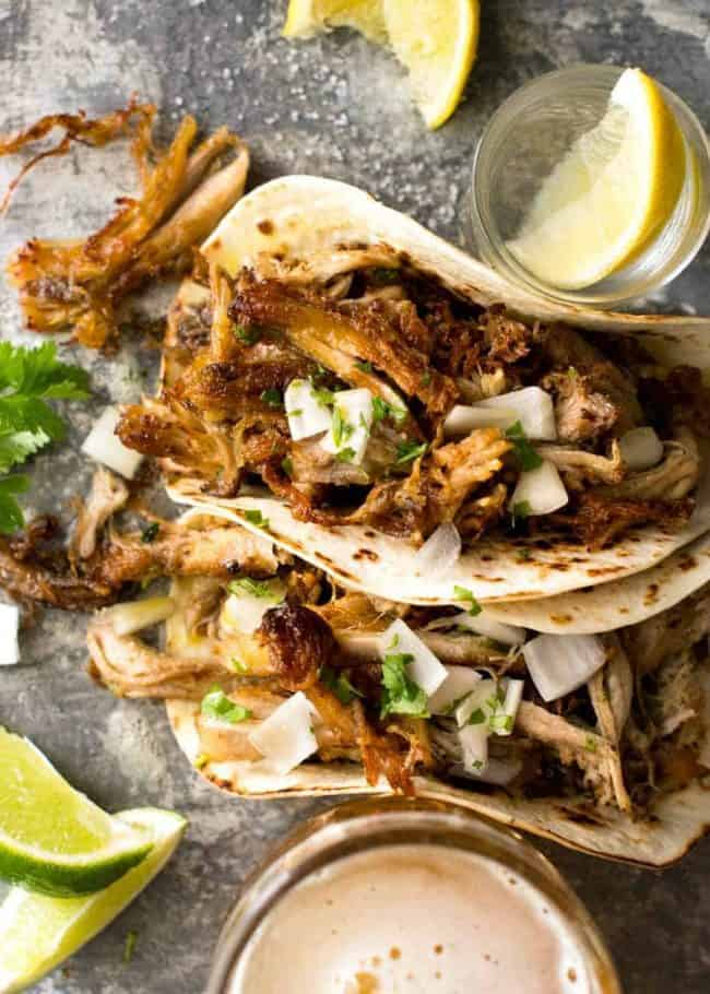 2. The Best Dang Pork Carnitas (outside of Mexico) - 2 Spoons 🥄🥄 - Alright, if you've ever had pork carnitas in Mexico, or late night from a taco truck at that corner gas-station-turned-food-truck heaven, you know REAL DEAL pork carnitas are to die for and can't really be recreated at home without the fire and the spit (and, frankly, the music). However, this is the best at-home version I've come across, and for the amount of work required, these are freaking delicious. The KEY to this version is the fresh orange juice. You can sub store-bought, but if you can, invest in a citrus squeezer and fresh oranges.Two-spoon rating for the post-cook fry-up step. It really DOES make a huge difference, but if you are short on time or energy, its still pretty good right out of the slow cooker and that makes it just one spoon.The blogger gives great meal ideas in the post, and any of the above I mentioned work with this dish too.