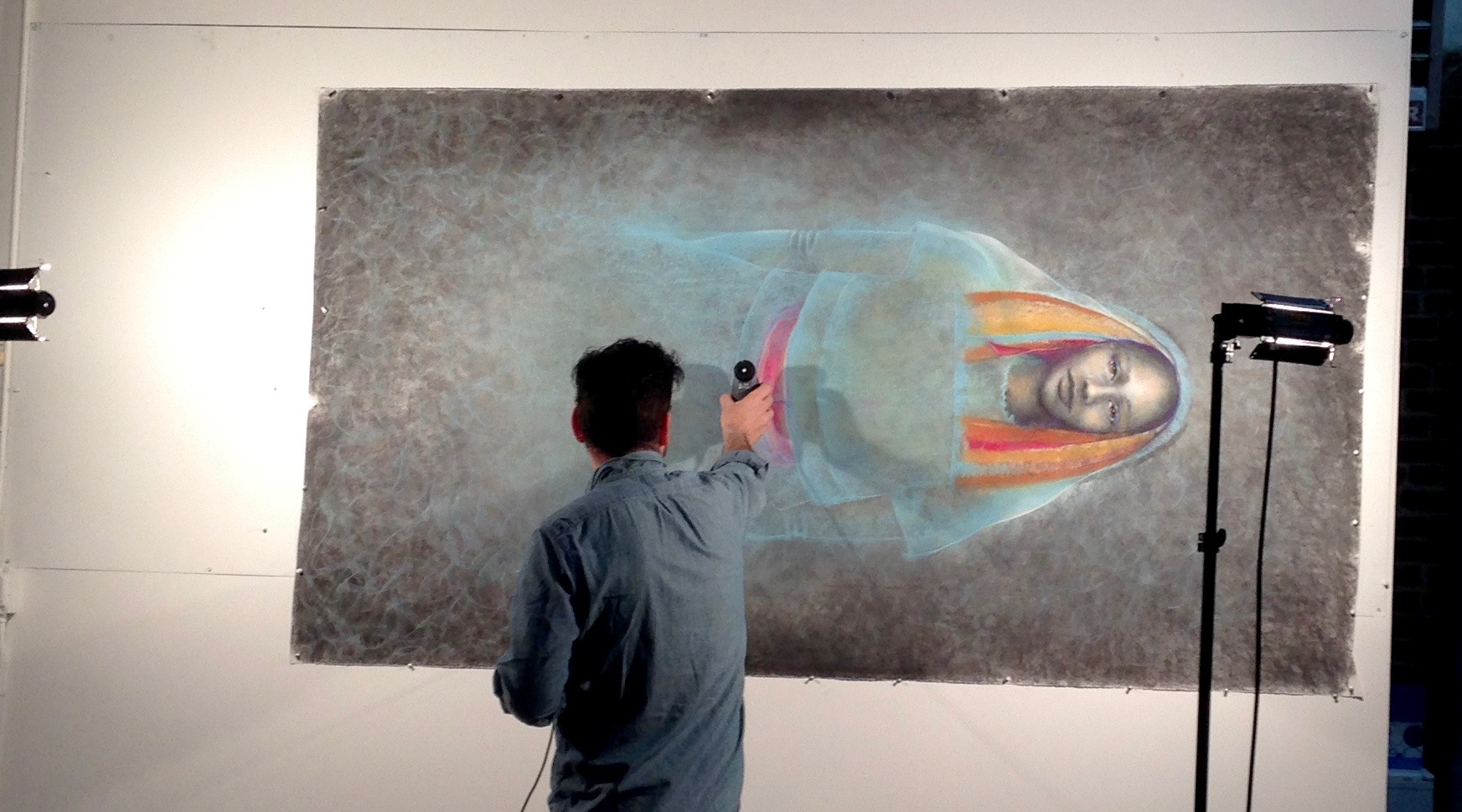 """Candela owner, Brad Boca, checking light settings in preparation for the process of the digital image capture of original drawing, """"Lamar."""""""