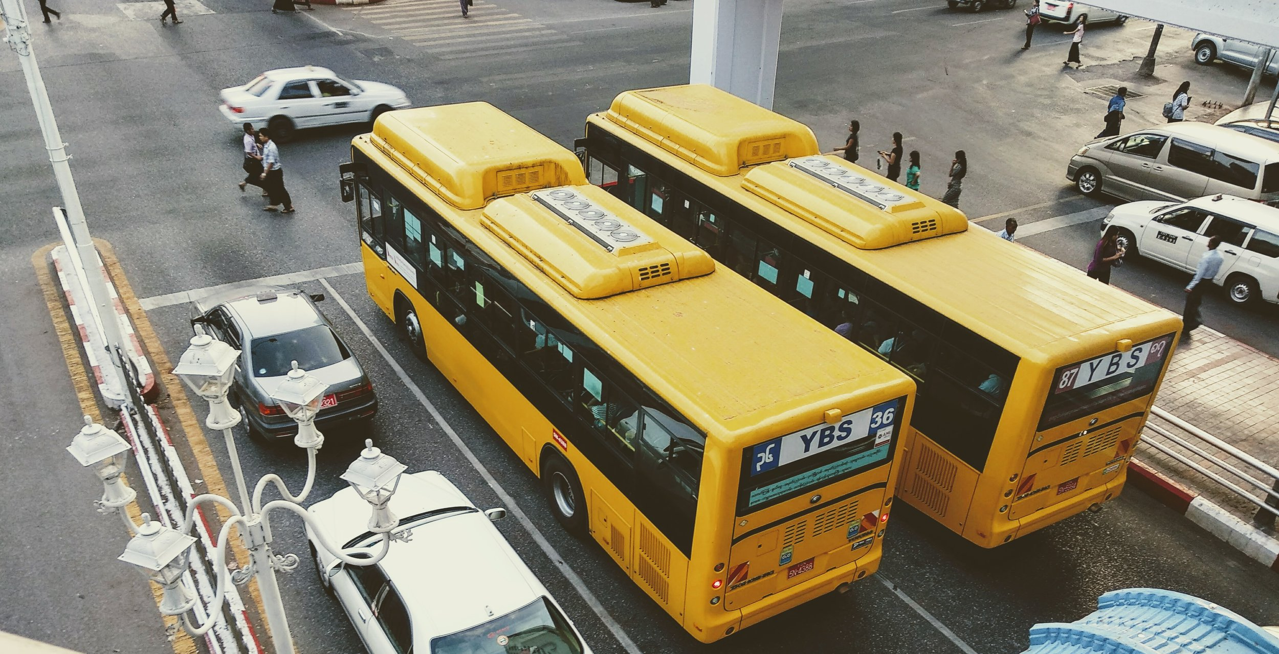 two buses at a city intersection