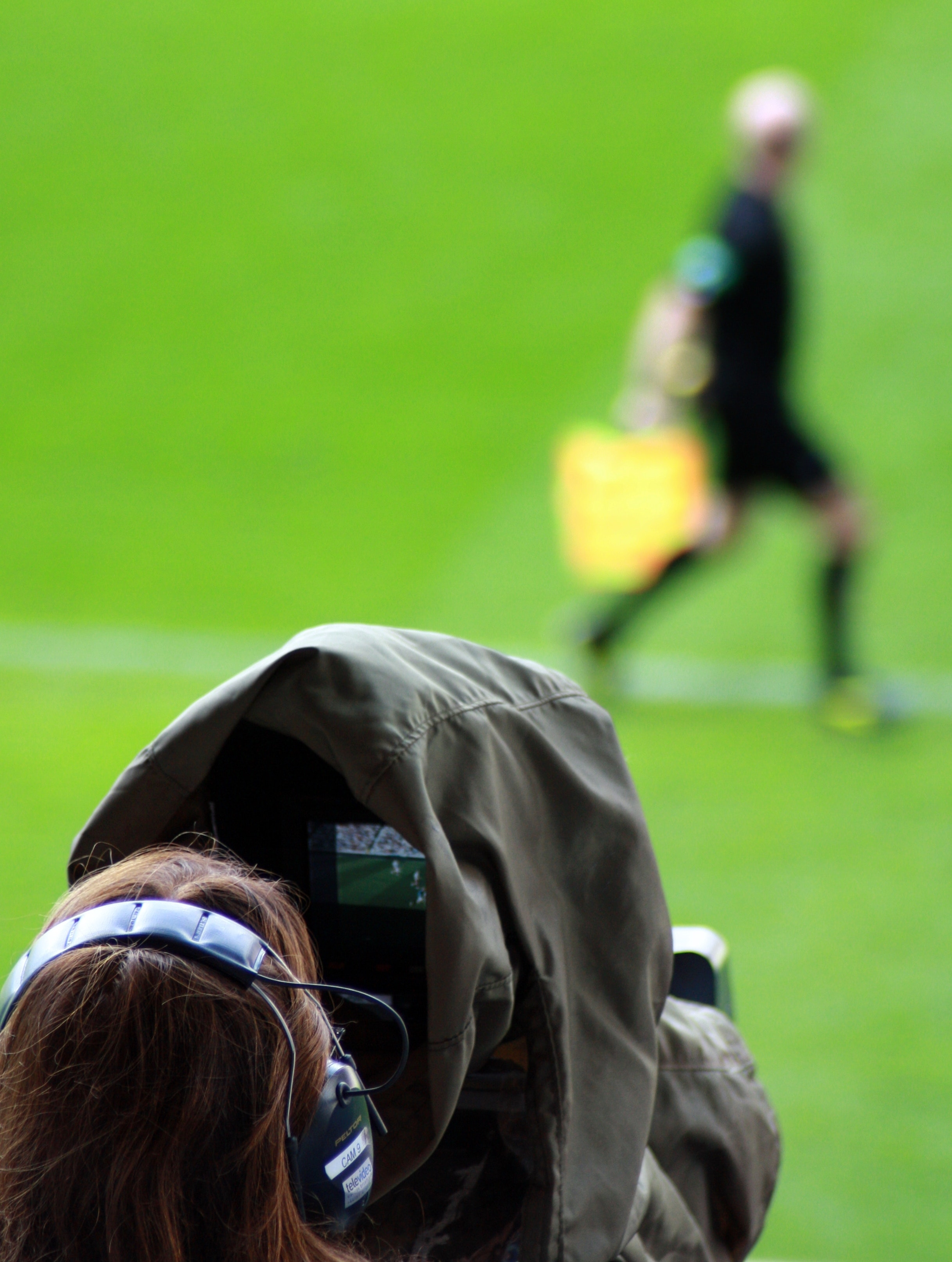 Camera person filming a soccer game