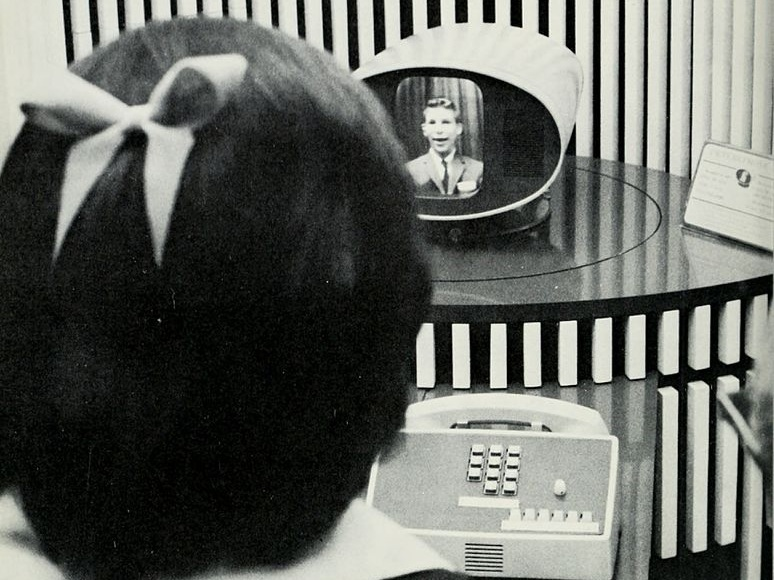 woman using a picture phone in the 1960's