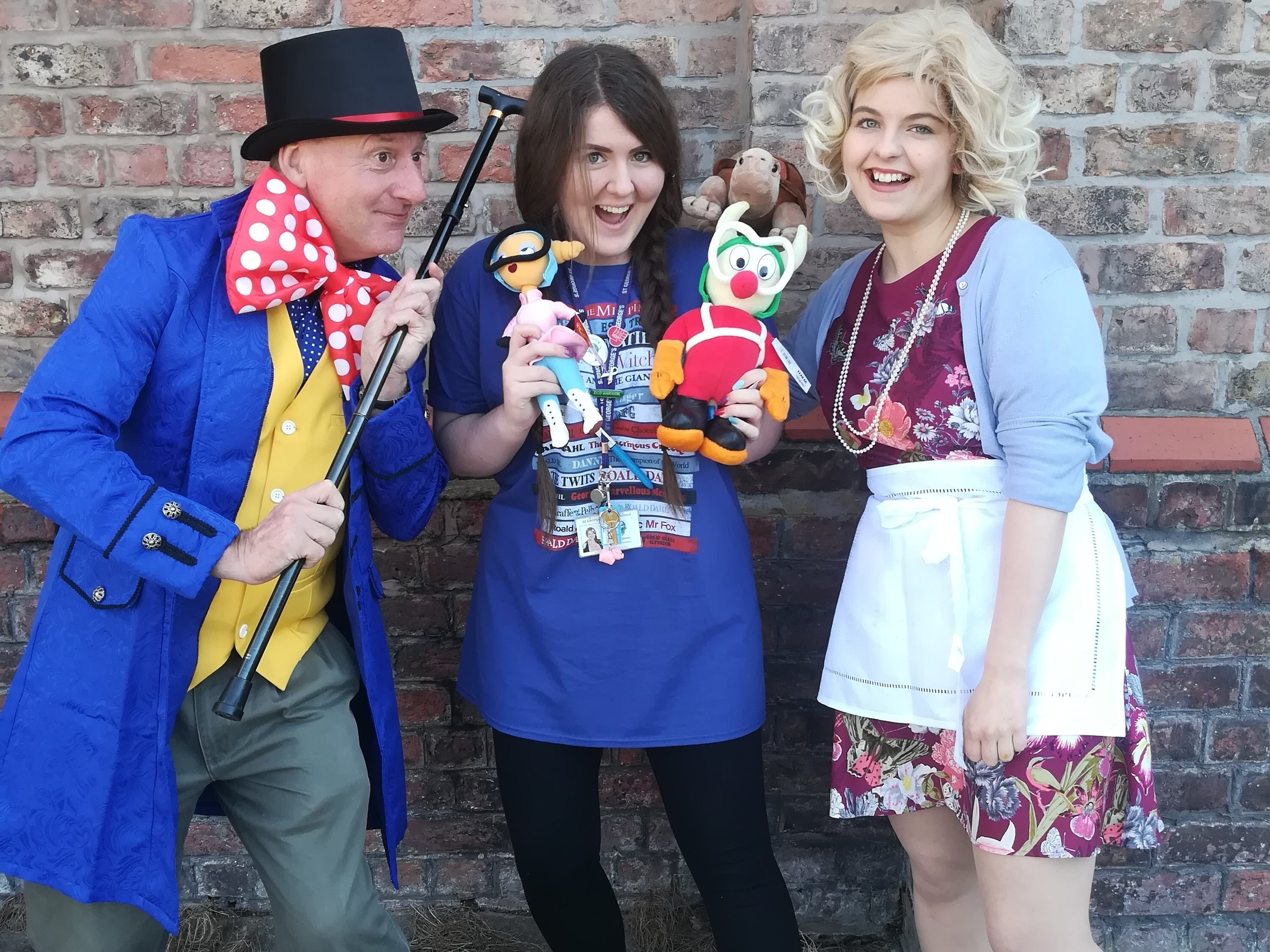 Photo of Holly (far right) and Tony Higginson from Beyond Books Media, dressed as Willy Wonka and Mrs Silver from Esio Trot.