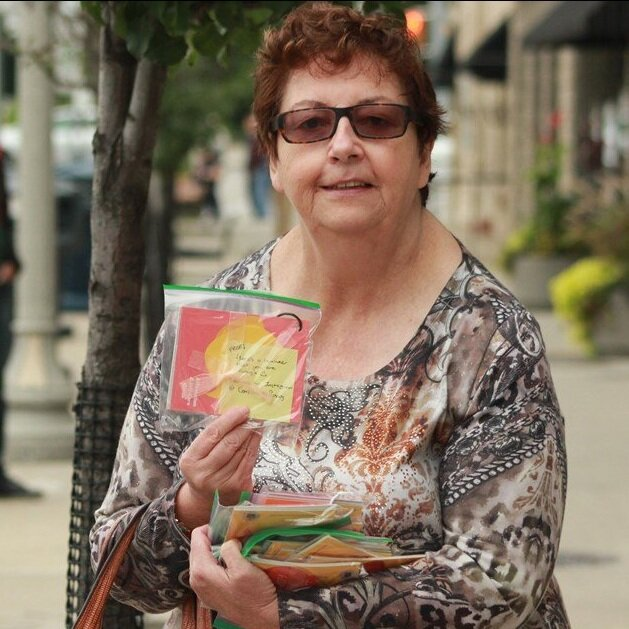 """Community members hide self-care booklets as part of bigger project. - By Anam Khan, Guelph Today, September 17, 2019""""Five community members walked around Downtown Guelph Monday hiding self-care booklets.""""""""With a bright orange cover page and a sticky note that reads 'Free! Here's a reminder that you are enough :)' the booklet contains gentle every reminders…"""""""