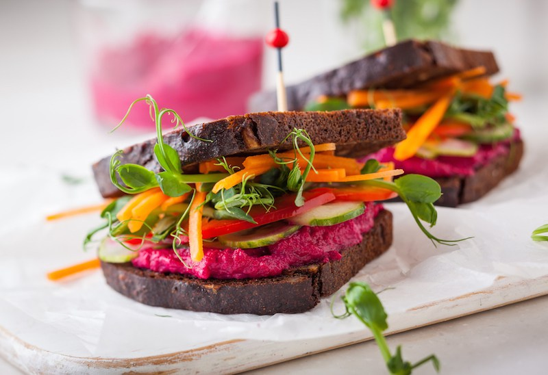 gluten-free-vegan-sandwiches-with-beet-hummus-raw-vegetables-and-sprouts.-soft-focus.jpg