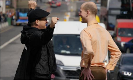 Choreographer Harold Rheaume and dancer Lewis Landini, on the streets of Edinburgh, during the first stage of filming for Katrina and Harold' s Paysages Élargis/ Widening Landscapes project, April 2019.  Image: Katrina McPherson