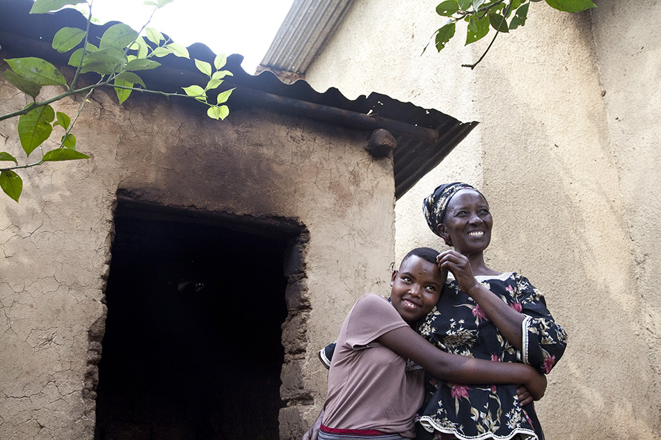 Florence Bayisenge, 16, was moved out of Mpore Pfefa Orphanage after six years and has lived with her foster mother, Pauline, in Kigali, Rwanda, for eight months.